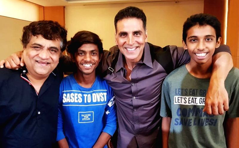 Actor Akshay kumar with Swanand Kirkire, the well-known writer, singer, actor and two time National Award winning lyricist, who is in the lead role of Chumbak that also stars new finds Sahil Jadhav ... - Akshay