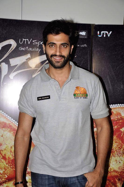 Actor Akshay Oberoi during a media interaction of film Pizza in Mumbai, on July 1, 2014. - Akshay Oberoi