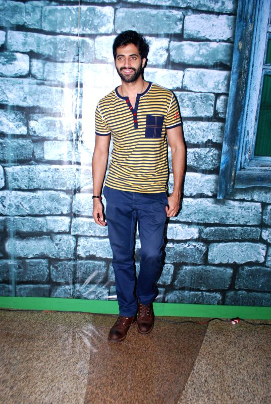 Actor Akshay Oberoi during the promotion of film Pizza in Mumbai on July 11, 2014. - Akshay Oberoi
