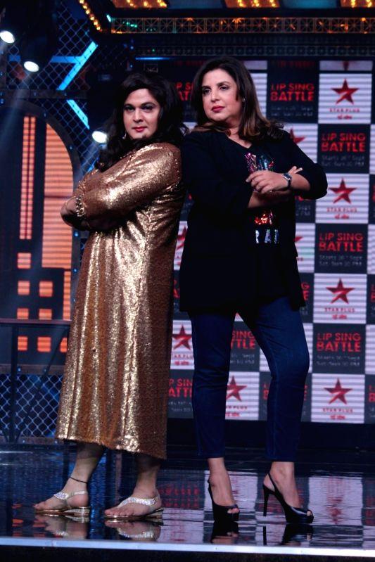 "Actor Ali Asgar Kunder and director Farah Khan during a press conference regarding Star Plus' show ""Lip Sing Battle"" in Mumbai on Sept 7, 2017. - Ali Asgar Kunder and Farah Khan"