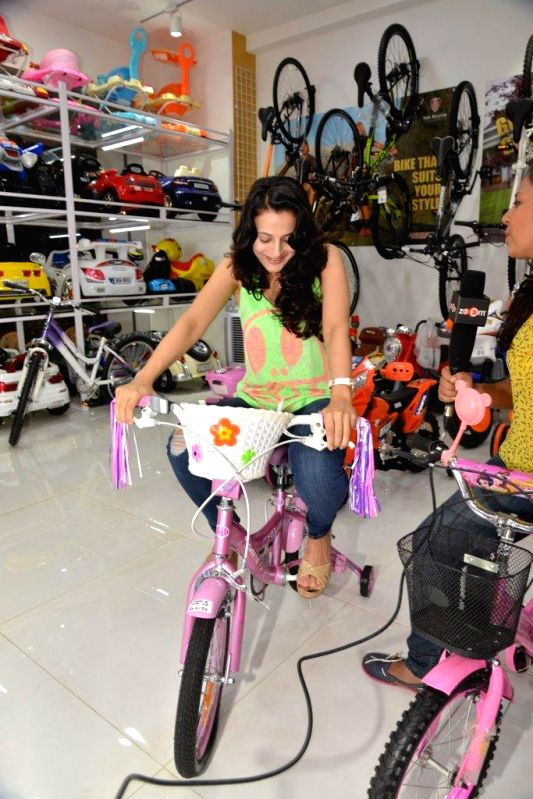 Actor Amisha Patel during the launch of a toy store `Riders`, in Mumbai, on Aug. 26, 2014.