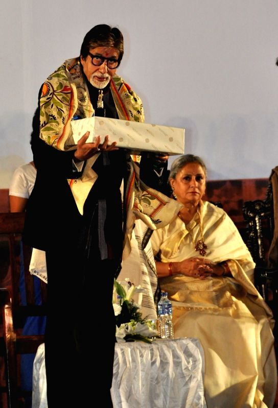 Actor Amitabh Bachchan addresses during the inauguration of the 21st Kolkata International Film Festival in Kolkata on Nov 14, 2015. - Amitabh Bachchan