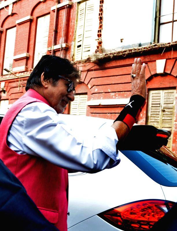 Actor Amitabh Bachchan arrives  at Writers' Building for shooting of his upcoming film `Te3n` in Kolkata on Nov 28, 2015.