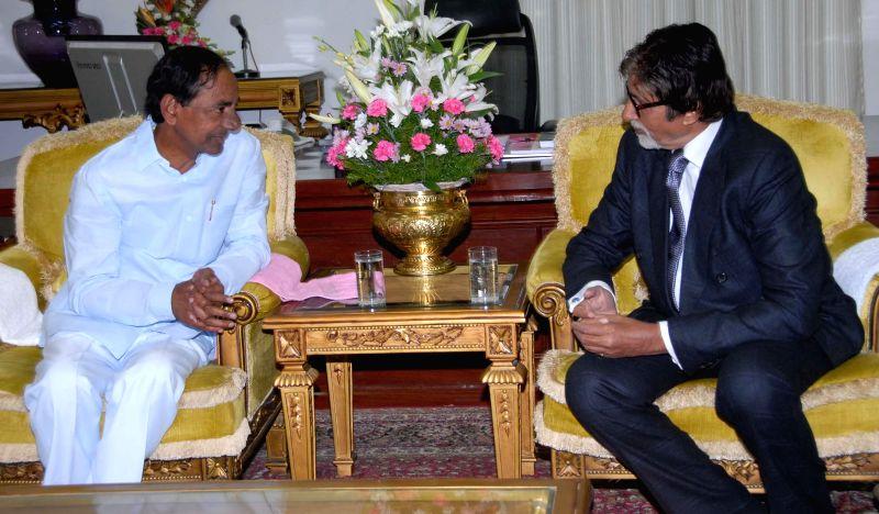 Actor Amitabh Bachchan meeting Telangana Chief Minister K. Chandrashekar Rao at his residence on Dec. 27, 2014.