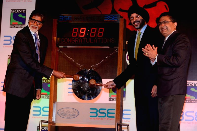 Actor Amitabh Bachchan rings the bell during an event organized to promote the upcoming television serial 'Yudh' at the Mumbai Stock Exchange (BSE) in Mumbai, on June 17, 2014 - Amitabh Bachchan