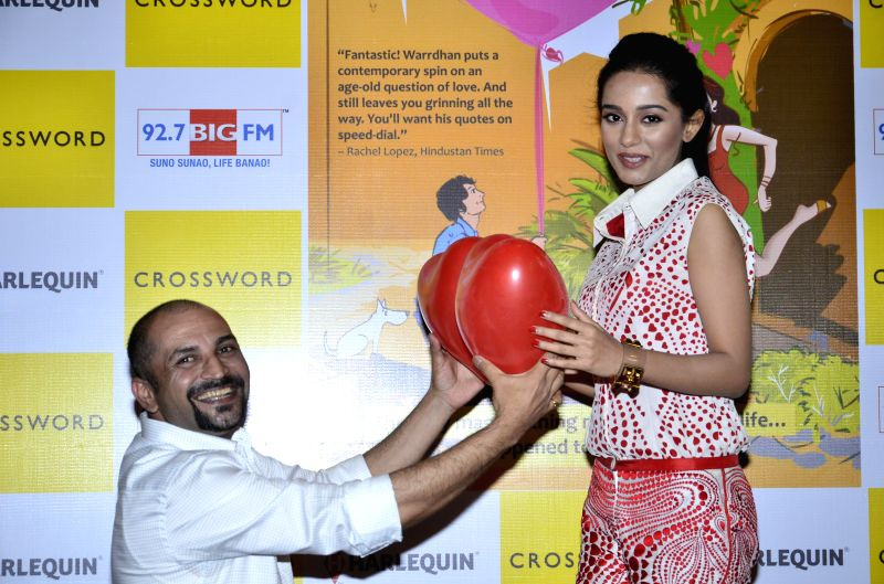 Actor Amrita Rao and Harsh Warrdhan during the launch of book `When Hari Met His Saali` by Harsh Warrdhan at Crossword store in Kemps Corner in Mumbai on June 24th, 2014.