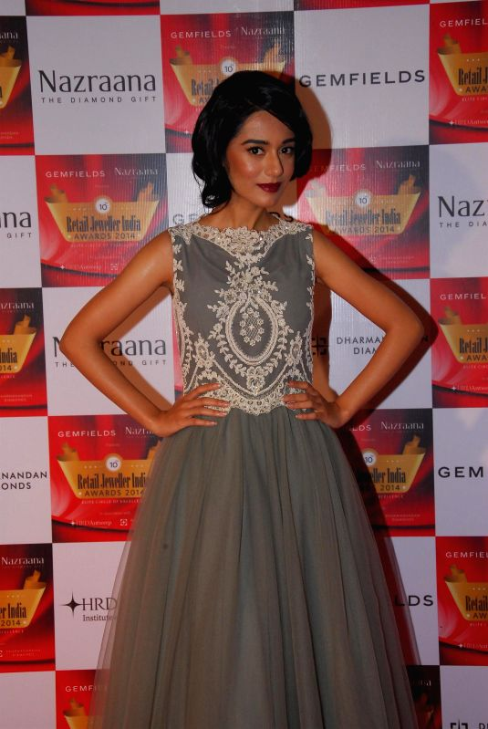 Actor Amrita Rao during the 10th Annual Gemfields and Nazraana Retail Jeweller India Awards 2014 in Mumbai on July 19, 2014. (Photo : IANS) - Amrita Rao