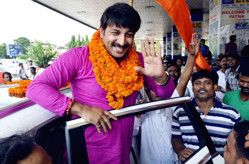 Actor and BJP MP Manoj Tiwari arrives at Patna Airport on July 12, 2014.