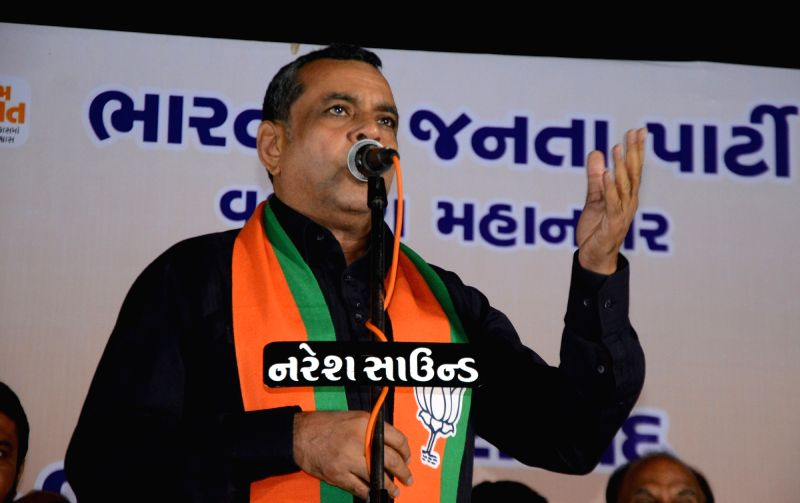 Actor and BJP MP Paresh Rawal addresses during a BJP rally in Vadodara on Dec 7, 2017.