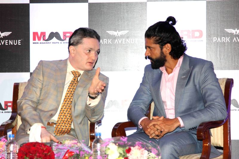Actor and filmmaker Farhan Akhtar and Gautam Singhania, CMD, Raymond Group during the launch of Park avenue deodorants in association with Men against Rape and Discrimination (MARD), in ...