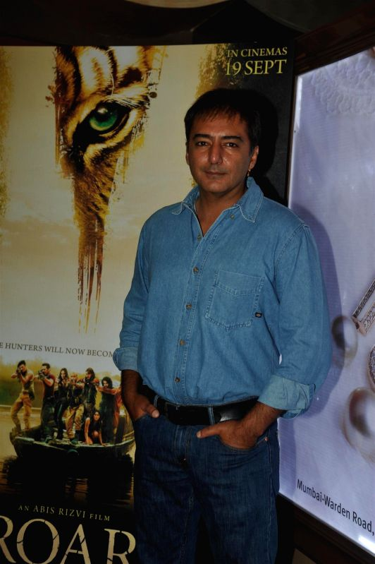 Actor and filmmaker Kamal Sadanah during the first look of film Roar in Mumbai, on July 31, 2014.