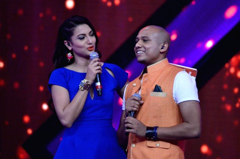Actor and host Gauhar Khan on the sets of reality show Indias Raw Star, in Mumbai, on Sep. 01, 2014. - Gauhar Khan