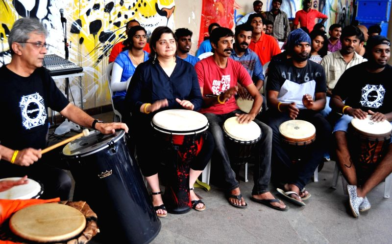 Actor and playback singer Vasudhara Das and others during her monthly 'Drumjam' session at Rangoli Metro in Bengaluru, on May 21, 2017.