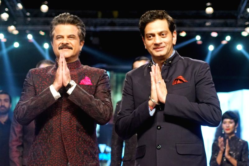 Actor and showstopper Anil Kapoor along with Fashion designer Raghavendra Rathore during Van Heusen + GQ Fashion Nights 2017 in Mumbai on Nov 11, 2017. - Kapoor