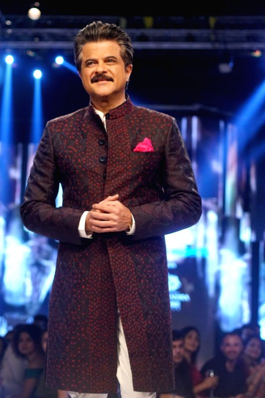 Actor and showstopper Anil Kapoor walks the ramp during Van Heusen + GQ Fashion Nights 2017 in Mumbai on Nov 11, 2017. - Kapoor
