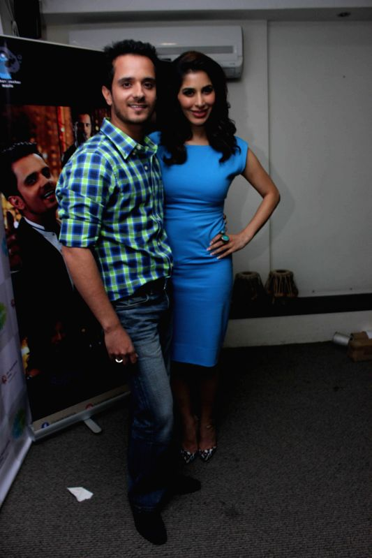 Actor and singer Sophie Choudry and singer Raghav Sachar during the media interaction on the release of the song Raat Akeli Hai in Mumbai on June 18th, 2014