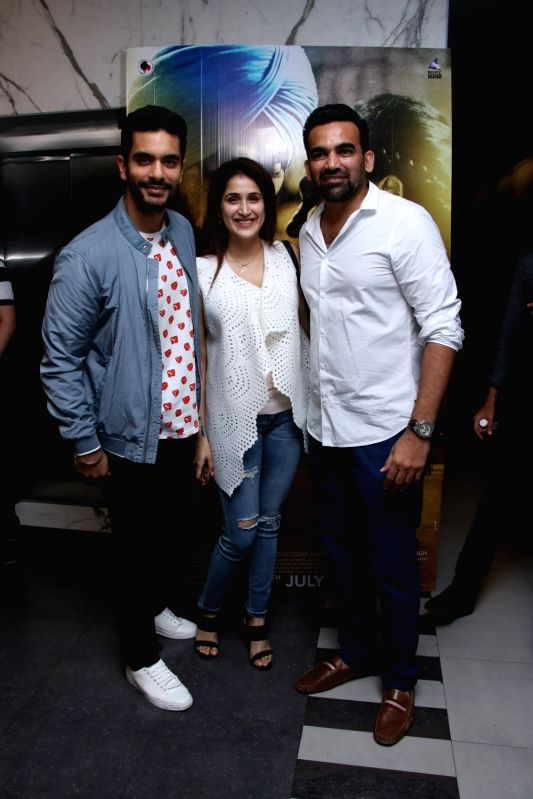 "Actor Angad Bedi and former cricketer Zaheer Khan with his wife Sagarika Ghatge at the special screening of upcoming film ""Soorma"" in Mumbai on July 11, 2018. - Angad Bedi and Zaheer Khan"