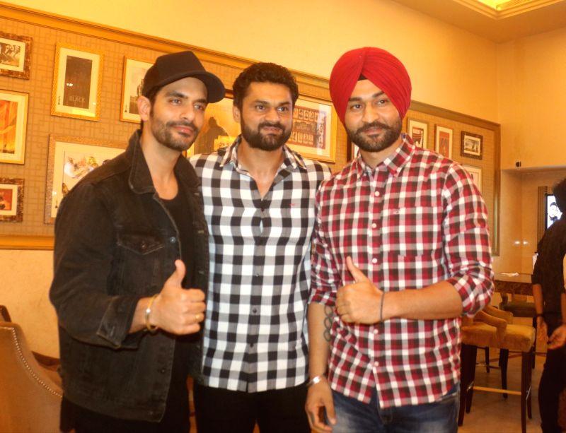 "Actor Angad Bedi and former Hockey player Sandeep Singh along with his elder brother Bikramjeet Singh at the special screening of film ""Soorma"" in New Delhi on July 19, 2018. - Angad Bedi, Sandeep Singh and Bikramjeet Singh"