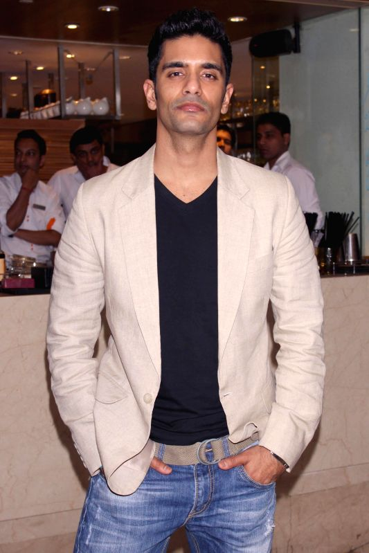 Actor Angad Bedi during a press meet of his upcoming film `Ungli` in New Delhi on Nov. 25, 2014. - Angad Bedi