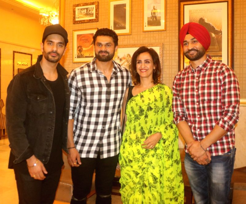 "Actor Angad Bedi, former Hockey player Sandeep Singh along with his elder brother Bikramjeet Singh at the special screening of film ""Soorma"" in New Delhi on July 19, 2018. - Angad Bedi, Sandeep Singh and Bikramjeet Singh"