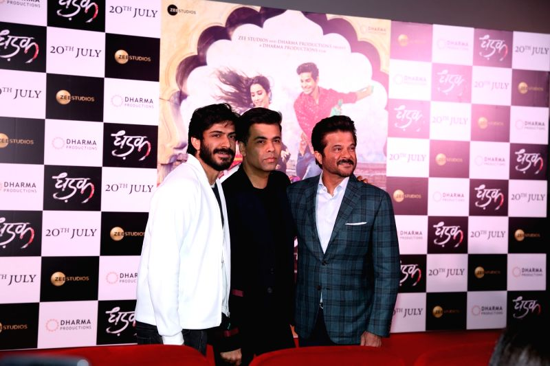 """Actor Anil Kapoor along with his son Harshvardhan Kapoor and producer Karan Johar at the trailer launch of upcoming film """"Dhadak""""  in Mumbai on June 11, 2018. - Anil Kapoor, Karan Johar and Harshvardhan Kapoor"""