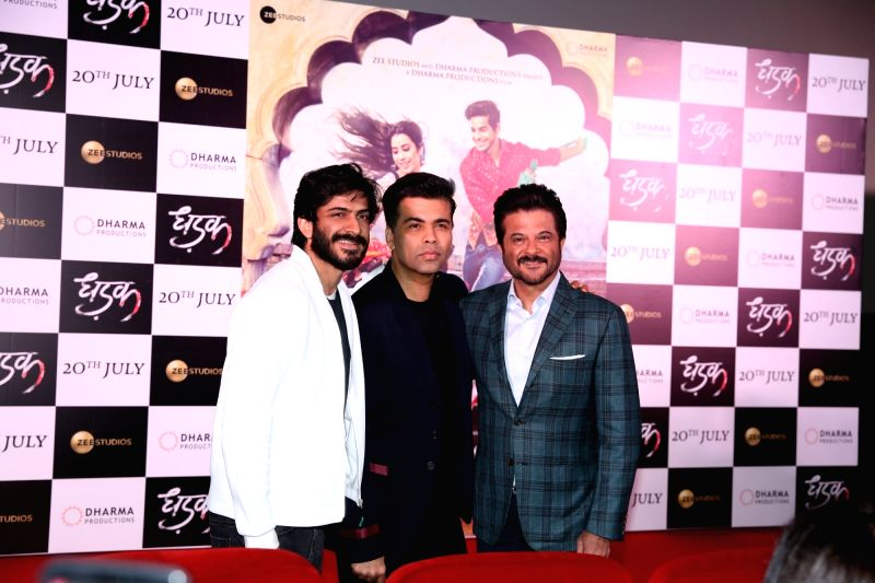 "Actor Anil Kapoor along with his son Harshvardhan Kapoor and producer Karan Johar at the trailer launch of upcoming film ""Dhadak""  in Mumbai on June 11, 2018. - Anil Kapoor, Karan Johar and Harshvardhan Kapoor"