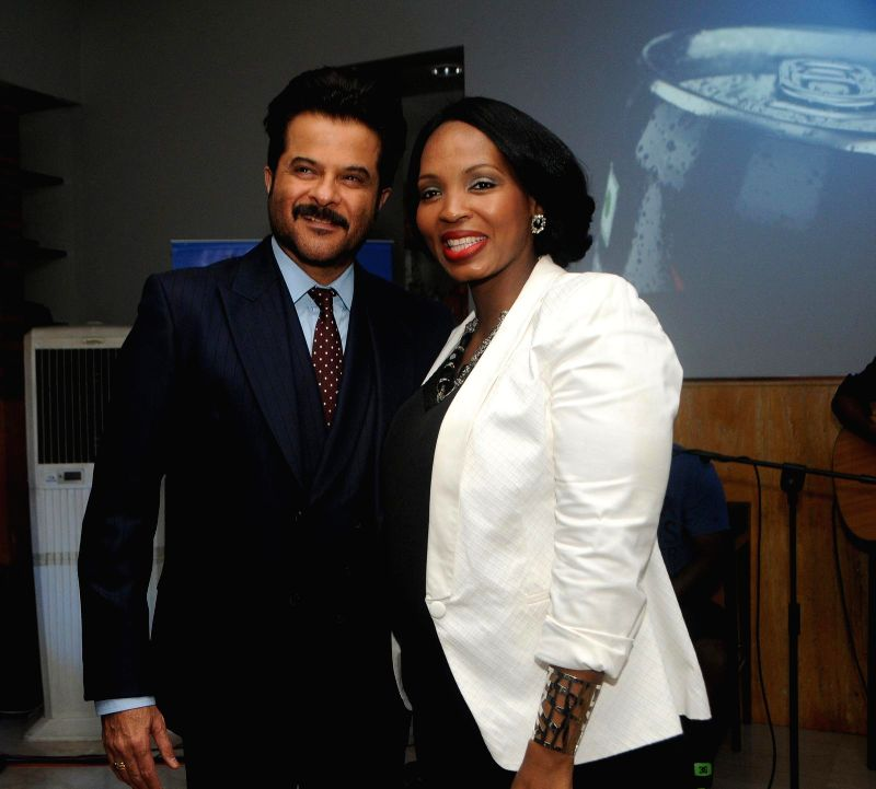 Actor Anil Kapoor and Pule Malefane`s wife during the first Death Anniversary function of South African Leader Nelson Mandela in Mumbai, on Dec 5, 2014.