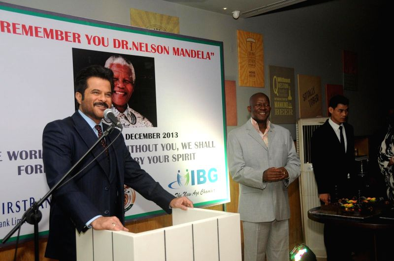 Actor Anil Kapoor and Pule, Malefane South African Consulate General during the first Death Anniversary function of South African Leader Nelson Mandela in Mumbai , on Dec 5, 2014.