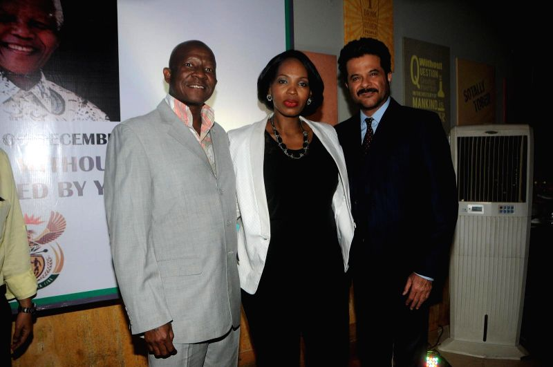 Actor Anil Kapoor and Pule Malefane, South African Consulate General his wife Lerato during the first Death Anniversary function of South African Leader Nelson Mandela in Mumbai, on Dec 5, 2014.