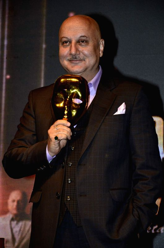 Actor Anupam Kher during the launch of new talk show, Kucch Bhi Ho Sakta Hai, in Mumbai on July 2, 2014. - Anupam Kher