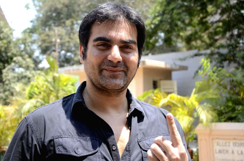 Actor Arbaaz Khan shows his fore finger marked with phosphorous ink after casting his vote during the sixth phase of 2014 Lok Sabha Polls in Mumbai on April 24, 2014.