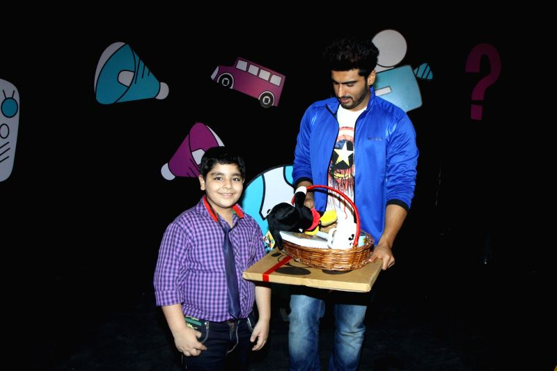 Actor Arjun Kapoor and Child actor Sadhil Kapoor on the set of Disneys Chat Show Captain Tiao in Mumbai on July 10, 2014. - Sadhil Kapoor