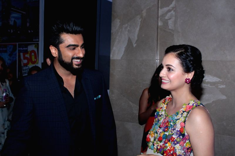 Actor Arjun Kapoor and Dia Mirza during The 6th Lonely Planet Magazine India Travel Awards 2017, in Mumbai on May 25, 2017. - Arjun Kapoor and Dia Mirza