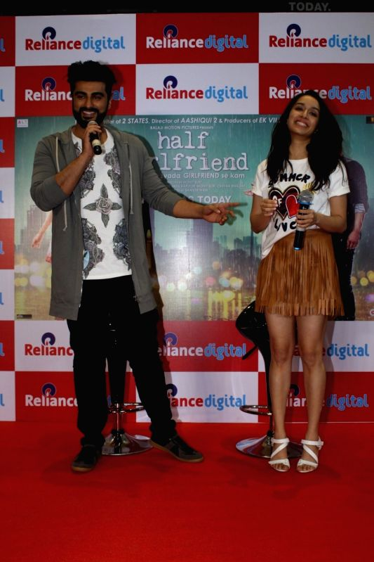 "Actor Arjun Kapoor and Shraddha Kapoor during promotions of their upcoming film ""Half Girlfriend"" Reliance Digital in Mumbai on May 19, 2017. - Arjun Kapoor and Shraddha Kapoor"