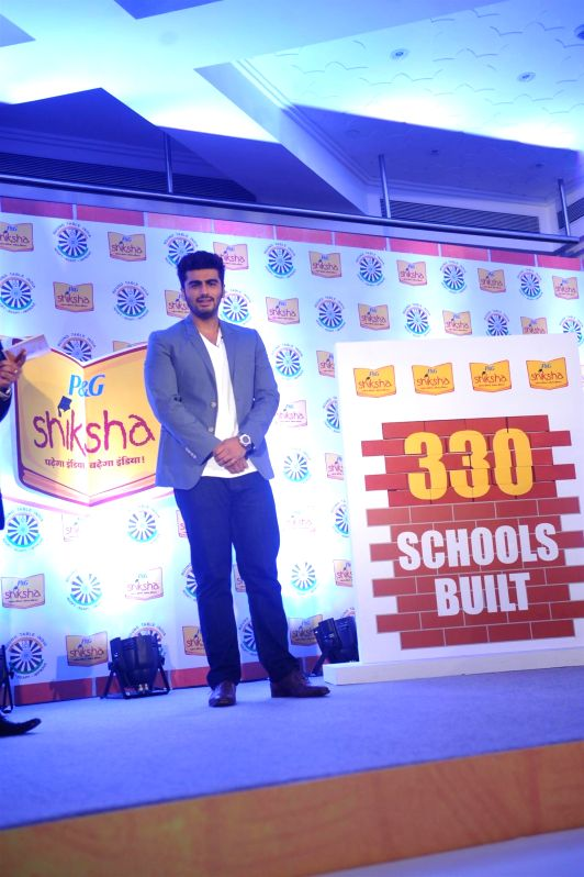 Actor Arjun Kapoor celebrate with kids during P&G Shiksha 2014 campaign in Mumbai, on May 5, 2014.