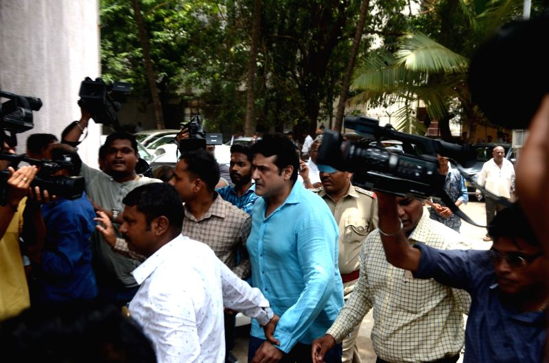 Actor Armaan Kohli being taken to be produced in a Mumbai court on June 13, 2018. - Armaan Kohli