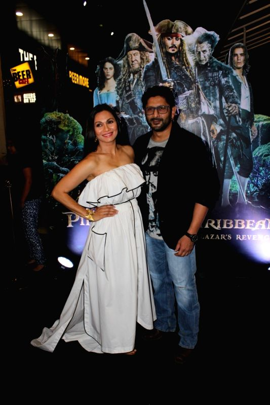 Actor Arshad Warsi along with his wife Maria Goretti during the screening of Hollywood film Pirates of The Caribbean: Salazar's Revenge in Mumbai on May 25, 2017. - Arshad Warsi