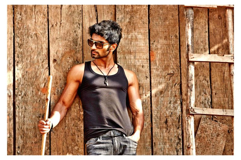 Actor Atharva Murali poses during a photoshoot.