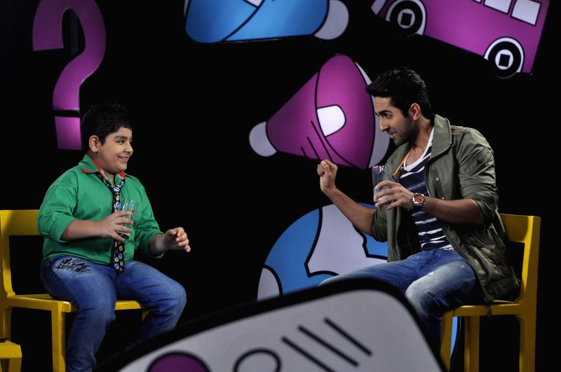 Actor Ayushman Khurana and Child actor Sadhil Kapoor on the set of Disneys Chat Show Captain Tiao in Mumbai on July 12, 2014. - Sadhil Kapoor