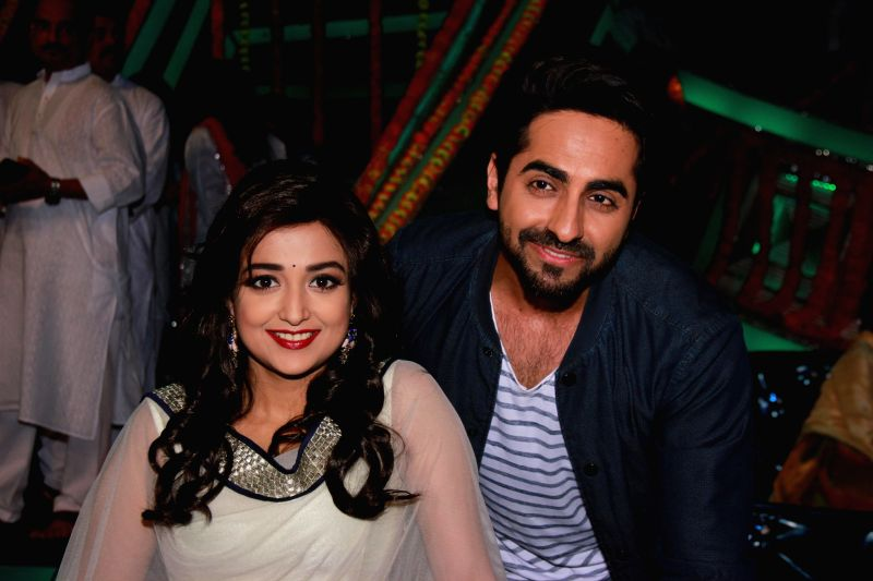 Actor Ayushman Khurana and singer Monali Thakur on the sets of Zee TV reality show Sa Re Ga Ma Pa Li`l Champs, in Mumbai on Feb 24, 2015. - Ayushman Khurana
