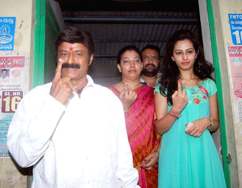 Actor Balakrishna Nandamuri shows his fore finger marked with phosphorous ink after casting his vote at a polling booth in Hyderabad on April 30, 2014. - Balakrishna Nandamuri