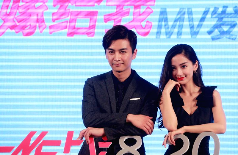"Actor Chen Xiao (L) and actress Angelababy attend a press conference of the movie ""Bride Wars"" in Beijing, capital of China, July 19, 2015. The movie is ... - Chen Xiao"