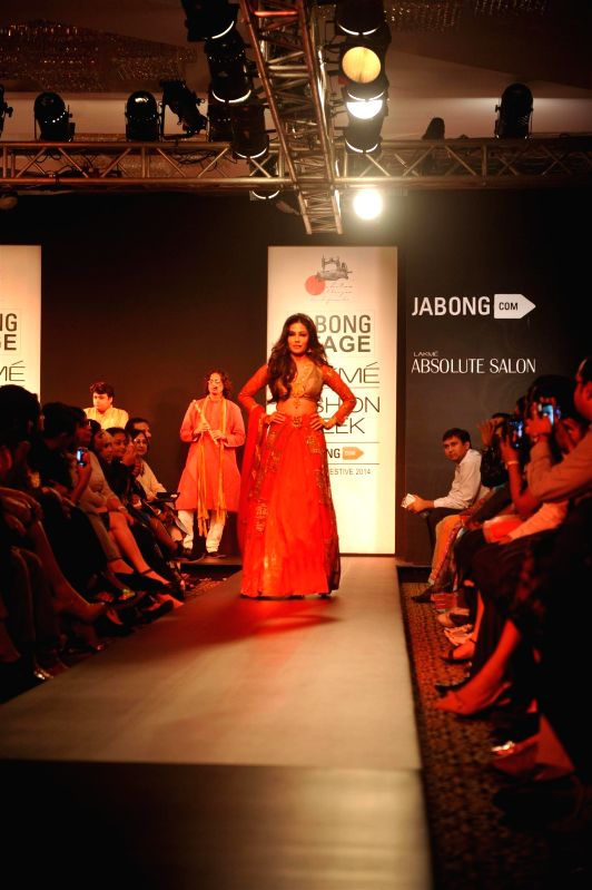 Actor Chitrangda Singh displays the creation of fashion designer Harshita Chatterjee Deshmukh during the Lakme Fashion Week (LFW) Winter/ Festive 2014 in Mumbai, on Aug. 21, 2014. - Chitrangda Singh and Harshita Chatterjee Deshmukh