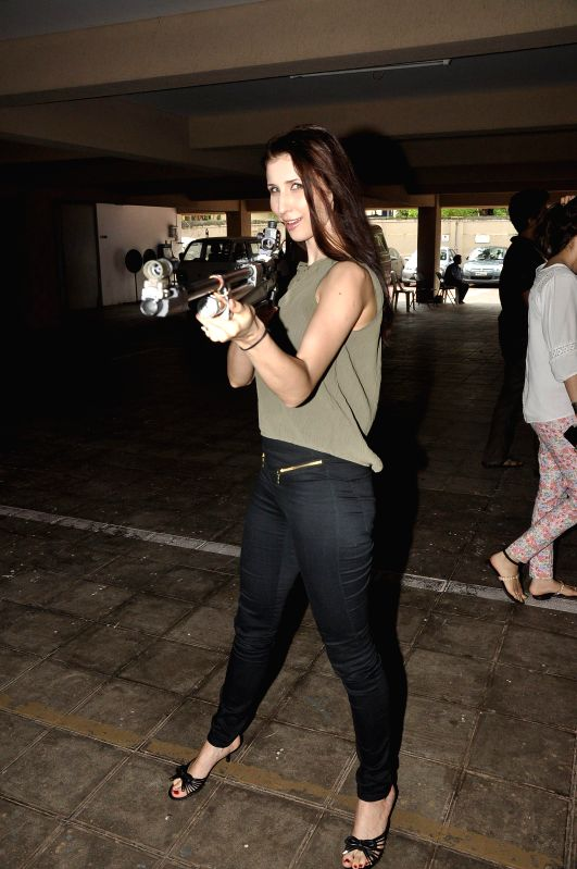 Actor Claudia Ciesla during the Mumbai Mayor Cup Shooting Competition 2014 to encourage the shooter and promote upcoming film Desi Kattey in Mumbai on July 14, 2014. - Claudia Ciesla