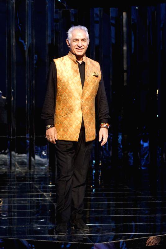 Actor Dalip Tahil walks the ramp for fashion designer Manish Malhotra's haute couture show, in Mumbai on Aug 1, 2018. - Dalip Tahil and Manish Malhotra