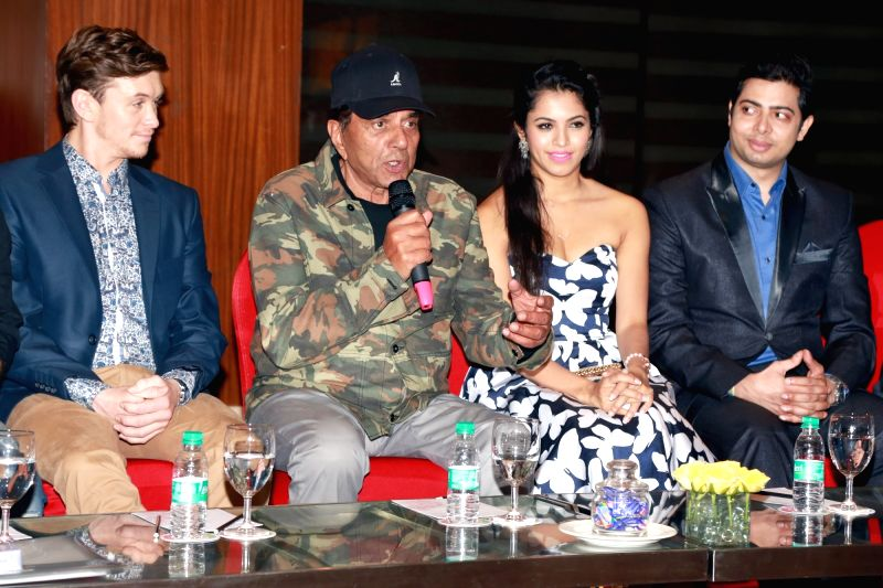 Actor Dharmendra addresses during a programme organised to promote `Dream Catcher` in New Delhi, on June 2, 2017. Also seen Pooja Priyanka and Travis Jeffery. - Dharmendra