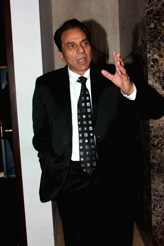 Actor Dharmendra during the launch of Carnival Cinemas in Mumbai on July 10, 2014. - Dharmendra