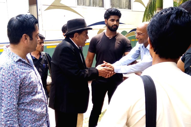 Actor Dharmendra interacts with his fans during shooting of his upcoming film in Gurgaon on May 30, 2017. - Dharmendra