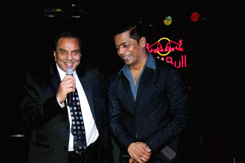 Actor Dharmendra with Shrikant Bhasi, Chairman of Carnival Group during the launch of Carnival Cinemas in Mumbai on July 10, 2014. - Dharmendra