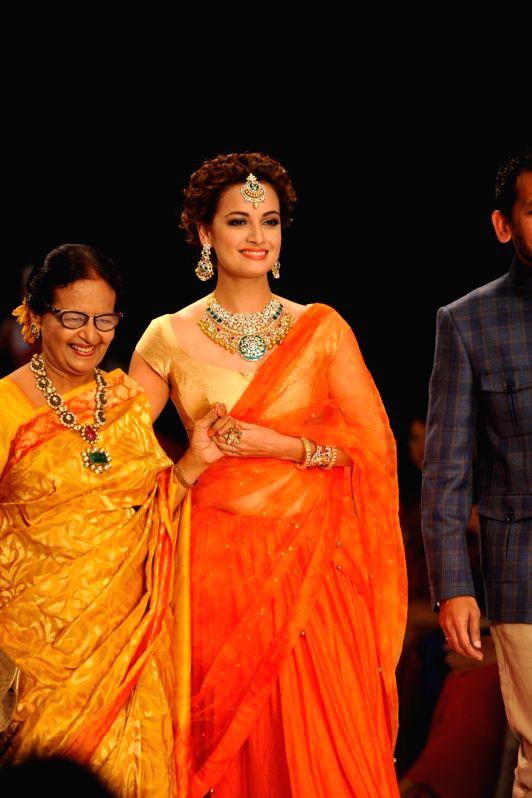 Actor Dia Mirza display jewellery by Shobha Shringar Jewellers during the India International Jewellery Week (IIJW) in Mumbai, on July 14, 2014.